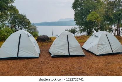 Lonavala, Maharashtra / India - Sept 29 2018: White tents at lake side - Pawna Lake