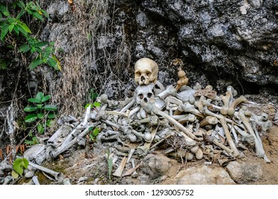 LONDA, RANTEPAO, SULAWESI - OCT 20,2009: piles of old bones and skulls are piled up in the caves and in the ravines of the rocky hills near the village of Londa, near Rantepao on October 20, 2009.