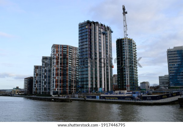 LONDON - 15TH FEBRUARY 2021: Royal Woolwich Arsenal apartments taken from the ferry on the River Thames.