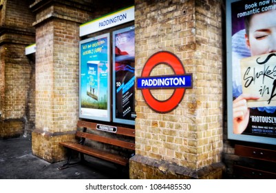 London; 16th of March 2015: A view of the Paddington undergroud sign on a brick column at tube station platform