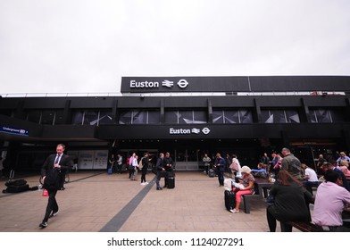 LONDON- 20 June 2018: Euston Station. Large railway terminus connected to the National Rail Network and London Underground. Exterior view of passengers walking in to main entrance.