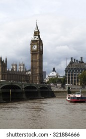 LONDON - 2015 AUGUST 5 : Panoramic view of Big Ben and Parliament Building from London Eye.Thousands cars, taxis, buses and pedestrians crossing River Thames on historic Westminster Bridge.