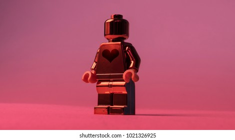 LONDON - 2018: Big shiny Lego toy man or woman with a big heart shape showing ready for love, be my valentine