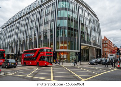 London - 2019: Park House and red double-decker bus.