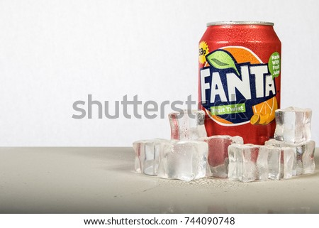 London, 24th October 2017:- A can of chilled Fanta with ice against a white background