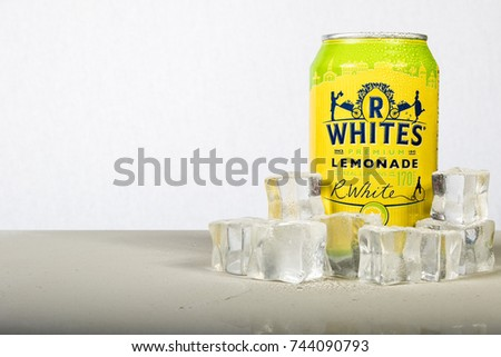 London, 24th October 2017:- A can of chilled R Whites Lemonade with ice against a white background
