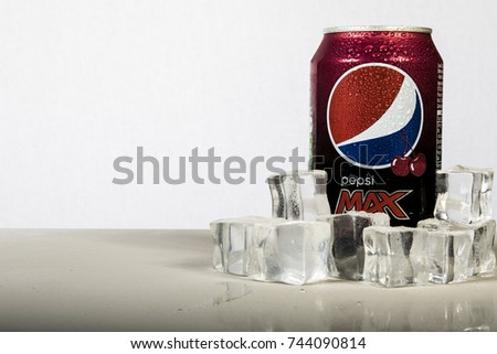 London, 24th October 2017:- A can of chilled Cherry Pepsi Max with ice against a white background