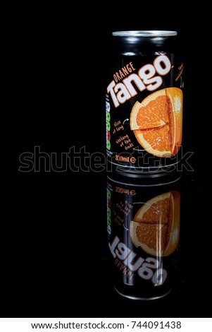 London, 24th October 2017:- A can of Orange Tango isolated on a black background