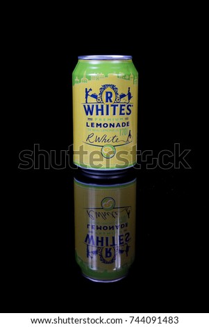London, 24th October 2017:- A can of R Whites Lemonade isolated on a black background