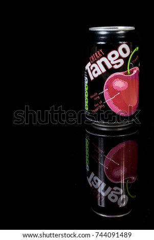 London, 24th October 2017:- A can of Cherry Tango isolated on a black background