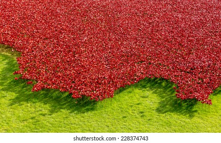 LONDON - 25 OCTOBER 2014: 'Blood Swept Lands and Seas of Red' at the Tower of London features 888,246 ceramic poppies, each of which represents a British and Commonwealth soldier killed in WW1.