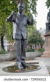 London, 28th September 2017:-Statue of Nelson Mandela in Parliment Square opposite the Palace of Westminster
