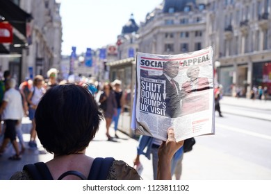 "London, 30th June 2018: Regent street, A woman holding a newspaper in NHS rally, which showing Mr. Trump and Mrs. May with the title ""shut down trump's uk visit""."