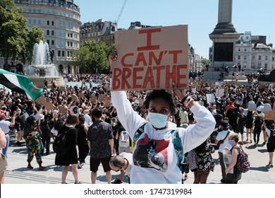 LONDON - 31ST MAY 2020: Black Lives Matter protest on Trafalgar Square in London. A girl holds a sign reading 'I can't breathe'.
