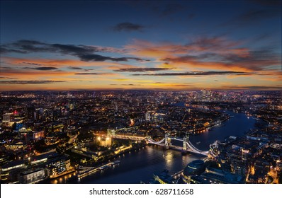 London aerial view with dominant of Tower Bridge in sunset light. Panoramic landscape with beautiful dramatic sky.