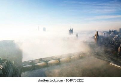 London aerial view seen from London Eye, heavy fog hits London. Image include Westminster Palace, Big Ben, Victoria Tower, Westminster Abbey.