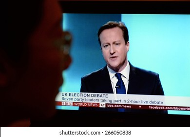 LONDON - APR 4:  A viewer watches Conservative Party PM David Cameron on an election TV debate on Apr 4, 2015 in London, UK. Major political parties joined the live TV debate ahead of polls on May 7.