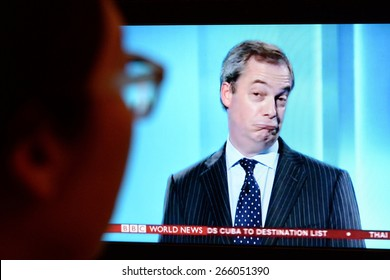 LONDON - APR 4:  A viewer watches UKIP leader Nigel Farage on an election TV debate on Apr 4, 2015 in London, UK. Major political parties joined the live TV debate ahead of polls on May 7.