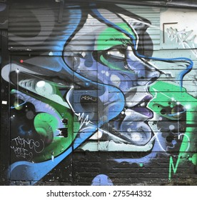 LONDON - APRIL 11, 2015. Street art on an old shed wall at Shoreditch in the Borough of Tower Hamlets, an area renown for its public painting in east London, UK.
