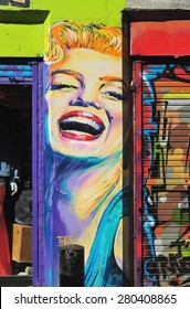 LONDON - APRIL 11, 2015. Street art of Marilyn Monroe painted between shopfronts at Shoreditch in the Borough of Tower Hamlets, an area renown for its public painting in east London, UK.