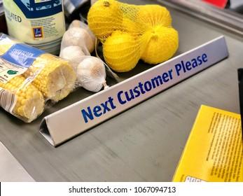LONDON - APRIL 11, 2017: Groceries on the checkout conveyor belt at Aldi supermarket in London, UK.