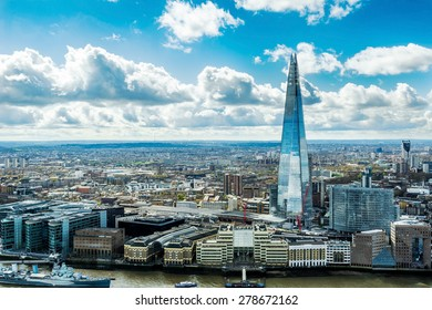 LONDON - APRIL 11: Overview of London with the Shard of Glass on April 11, 2015 in London, UK. Standing 306 metres high, the Shard is currently the tallest building in the European Union.