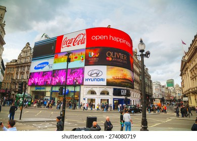 LONDON - APRIL 12: Piccadilly Circus junction crowded by people on April 12, 2015 in London, UK. It's a road junction and public space of London's West End in the City of Westminster, built in 1819.
