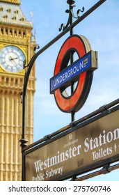 LONDON - APRIL 12: London underground sign at the Westminster station on April 12, 2015 in London, UK. The system serves 270 stations and has 402 kilometres of track, 52% of which is above ground.