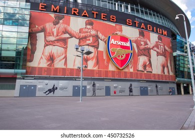 LONDON - APRIL 12,2016. One of the 8 murals installed on the exterior of Arsenal FC Emirates Stadium, the Arsenalisation project depicting four Arsenal legends linking arms, London, England.
