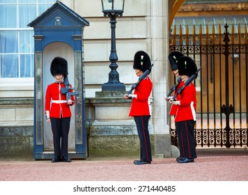 LONDON - APRIL 13: Queen's Guards at the Buckingham palace on April 13, 2015 in London, UK. It's the name given to the contingent of infantry guarding Buckingham Palace and St James's Palace.