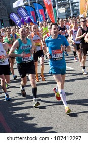 LONDON - APRIL 13: Unidentified men run the London marathon on April 13, 2014 in London, England, UK. The marathon is an annual event.