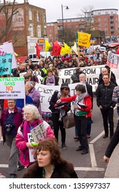 """LONDON - APRIL 13TH: Unidentified people protest at the Thousand Mothers March for Benefit Justice in Tottenham, London on April the 13th 2013.  The """"bedroom tax"""" effects the working class people."""