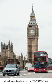 LONDON - APRIL 15, 2013: Classic red British double decker bus moving in front of Big Ben on Westminster Bridge. Designed by the Swiss architect C. Labelye, it has an overall length of 252 metres.