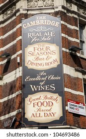 LONDON - APRIL 15: English pub sign, Public house, known as pub, is focal point of community, on April 15, 2012, London, UK. Pub business, now about 53,500 pubs in UK, has been declining every year
