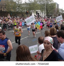 LONDON - APRIL 17: Crowds cheering the virgin 2011 London marathon runners, at tower bridge, London, April 17, 2011.