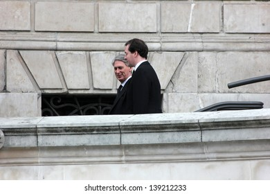 LONDON - APRIL 17: George Osborne and Philip Hammond leave the funeral service for Margaret Thatcher at St. Paul's Cathedral on April 17, 2013 in London.