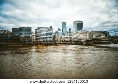 LONDON - APRIL 17. The View from the south bank, across the River Thames with commercial skyscrapers dominating the Financial District skyline on April 17, 2017 in London, UK.