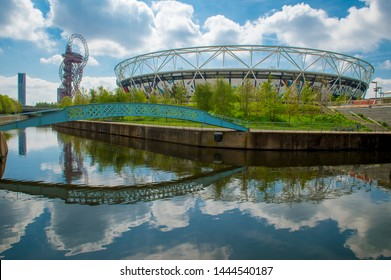 LONDON - APRIL 20, 2019: London Stadium reflects in one of the Bow Back Rivers, which were cleaned up when the Stratford area was revitalized for the 2012 Olympics.
