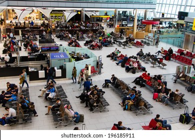LONDON - APRIL 20: People in waiting room at Heathrow airport on April 20, 2013 in London, England. Heathrow is one of largest world airports.