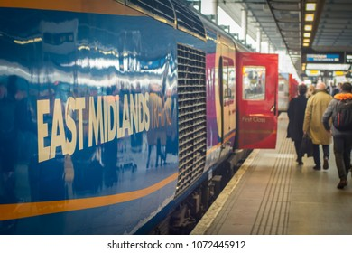 LONDON- APRIL, 2018: East Midland Train and passengers on platform at St Pancras Station