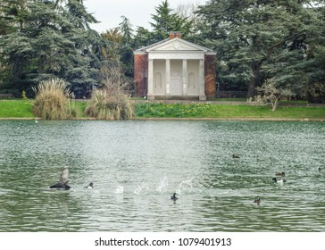 LONDON- APRIL, 2018: Gunnersbury Park pond and gardens in Hounslow, west London, UK.  A large park with museum and cafe