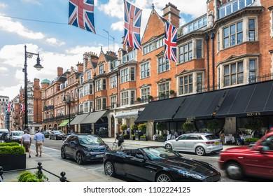 LONDON- APRIL, 2018: Mayfair street scene on Mount Street, an upmarket red brick shopping high street in Mayfair