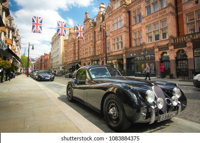LONDON- APRIL, 2018:  An old classic Jaguar car parked on Mount Street in Mayfair, a luxury area of London's west end