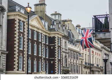 LONDON- APRIL, 2018: Row of buildings on Pall Mall in the St James area of central London- an iconic London road of historic luxury offices, private clubs and apartments