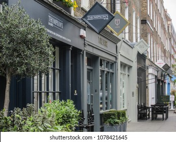 LONDON- APRIL, 2018: Seymour Place in Marylebone, west London. An upmarket shopping street close to Baker Street with fashion shops, cafes and restaurants