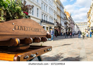 LONDON- APRIL, 2018: Shopping high street in London's Covent Garden district, area of upmarket shops, restaurants and theatres
