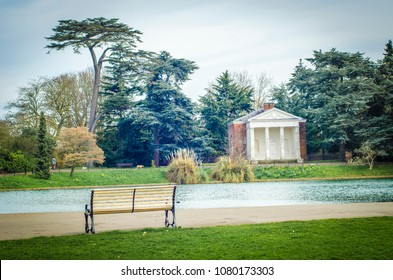 LONDON- APRIL, 2018: View of Gunnersbury Park, an empty bench and pond area of this large park in Hounslow, West London