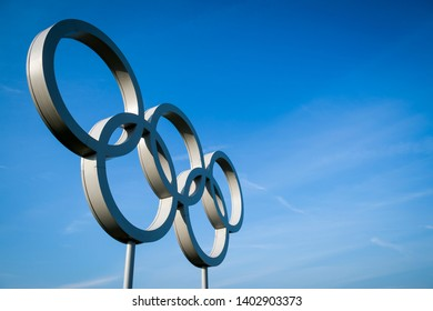 LONDON - APRIL, 2019: Metallic silver Olympic Rings stand under bright blue sky.