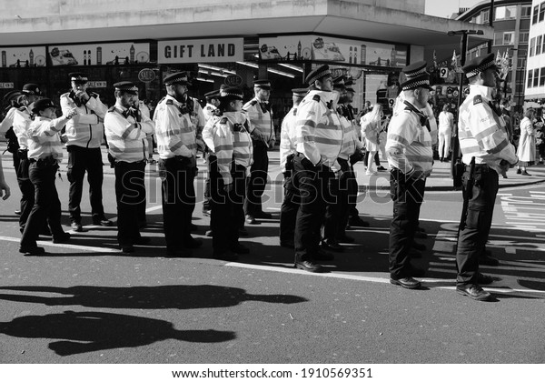 LONDON - APRIL 2019: Metropolitan Police lining up to make arrests at an Extinction Rebellion protest on Oxford Circus.
