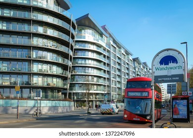 LONDON- APRIL, 2019: Street view of apartment buildings and traffic outside Battersea Park in Wandsworth, south west London